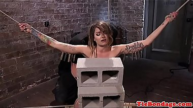Tattooed bondage sub gags while pussytoyed