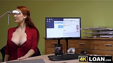 Redhaired babe shows off big tits before office hammering