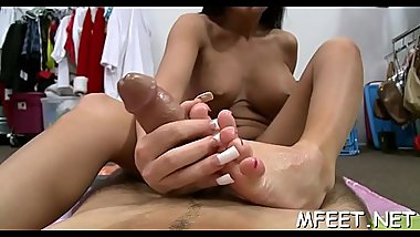 Alluring and skillful brunette hair manages to mix a footjob and a blowjob