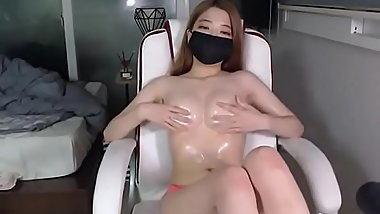Busty Asian oils her big tits - check link for more