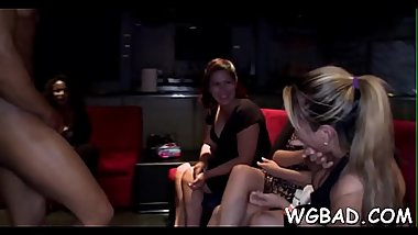 Sexy stripper is getting his shlong sucked by several babes