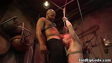 BDSM sub dominated over by hunk