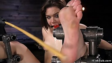 Brunette drooling in metal device bondage