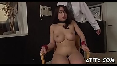 Asian strokes her own boobs before giving hot oral stimulation stimulation