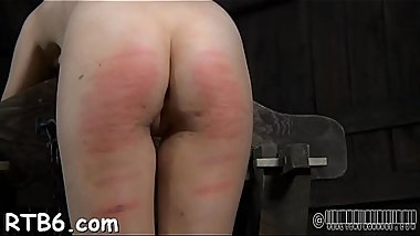 Tied up slave receives lusty pleasuring her naughty snatch