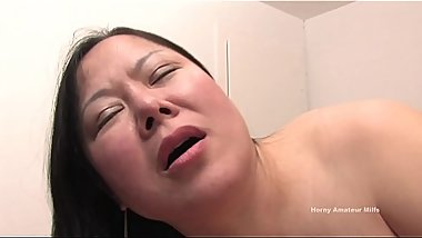 Asian woman Feng fucked missionary style and takes cum on her body