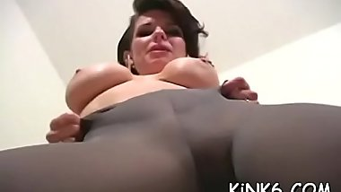 Horny gal tries to push her finger inside cunt through tights